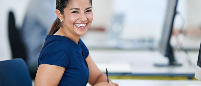 Woman Smiling In Corporate Office