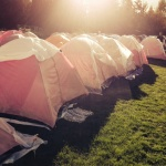 Komen Tents On Grass